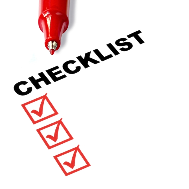 Checklist with red felt pen, and checked boxes.